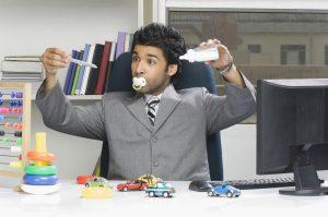 bigstock-Businessman-behaving-like-a-ki-84906197.jpg